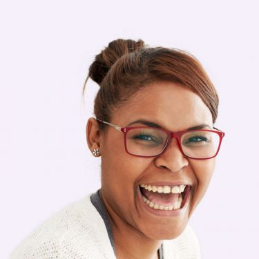 Young woman with glasses big smile