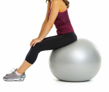 Young lady fit ball pelvic floor exercies