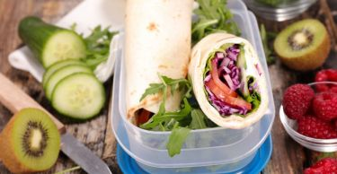 Healthy lunchbox salad wrap and fruit