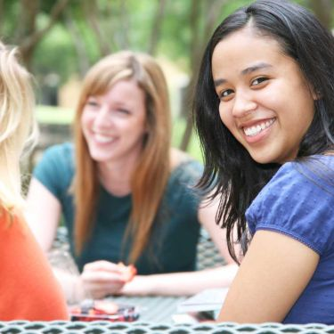 Group girls table smiling pcos booklet